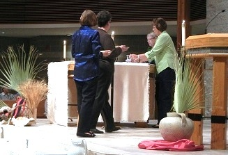 "Members of the Worship & Spirituality Committee ""setting"" the altar at the Holy Thursday Liturgy"